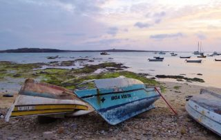 Fisherboats at twilight in the bay of Sal Rei on Boa Vista island