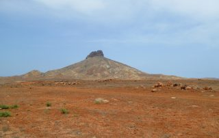 Desert and ancient volcanic chimneys characterize the island interior of Boa Vista